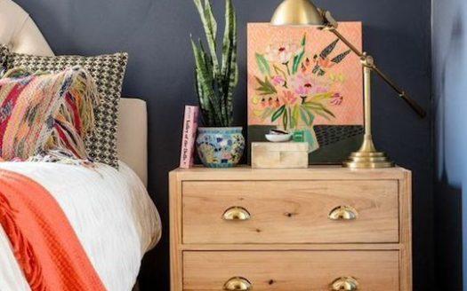 wooden nightstand gold handles navy wall
